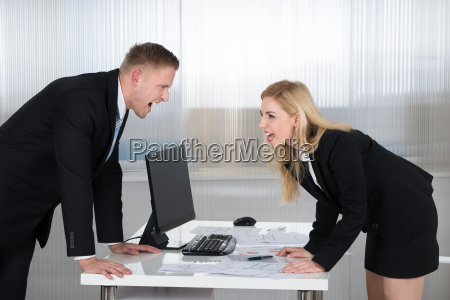 business people shouting at each other