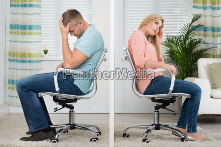 upset couple sitting on chairs at
