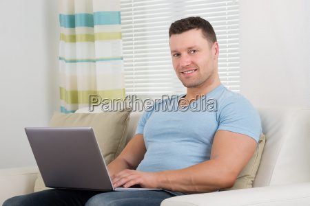 portrait of man using laptop on