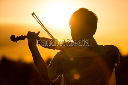 young man or boy playing the