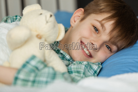 happy boy with his teddy bear