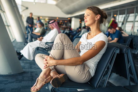 pretty young woman waiting at a