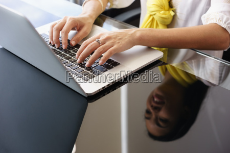 business woman smiling and typing on