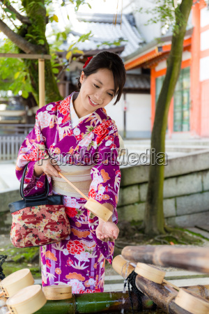 japanese woman washing hand before go