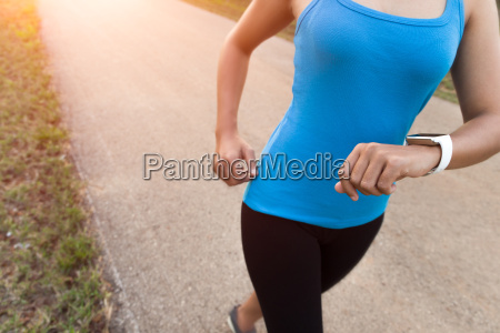 closeup woman running on rural road