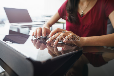 woman using tablet computer for daily
