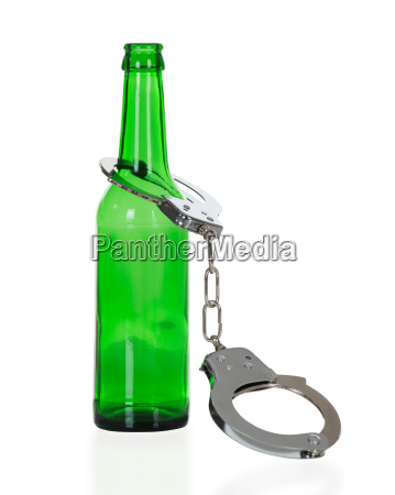 handcuffs in green beer bottle