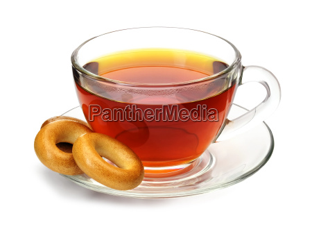 cup of black tea with bagels