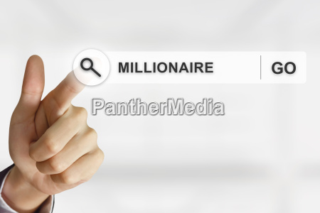 business hand clicking millionaire button on