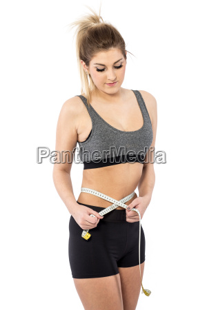 woman measures the abdominal circumference with