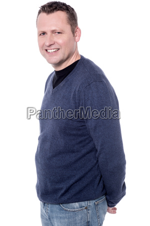 man posing with hands behind his