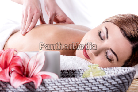 relaxing woman at beauty spa