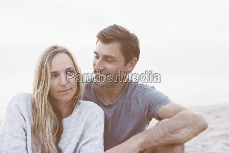 a couple sitting close on a