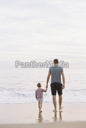 man standing on a sandy beach