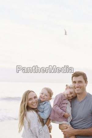 couple standing with their son and