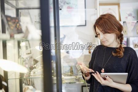 a mature woman holding a digital