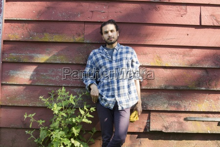 bearded man wearing a checked shirt