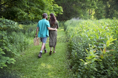 a man and woman walking through