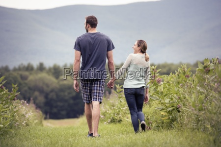 a couple man and woman walking