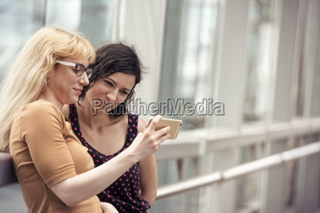 two women side by side looking