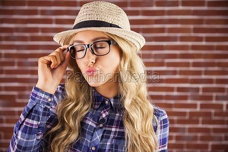 gorgeous blonde hipster sending air kiss