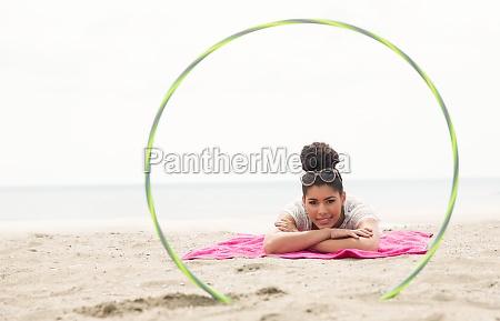 smiling woman looking at camera through