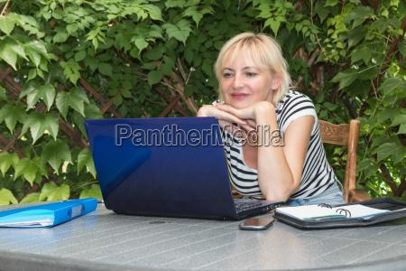 blonde woman in outdoor office