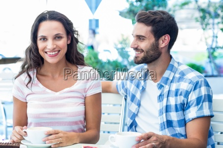 cute couple sitting outside at a