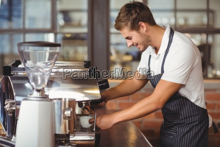 handsome barista making a cup of
