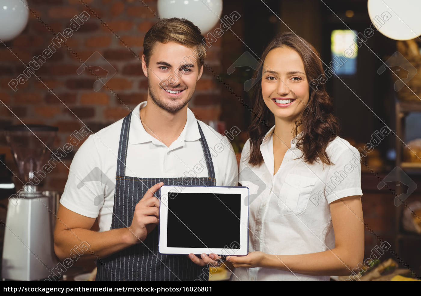 smiling, co-workers, showing, a, tablet - 16026801
