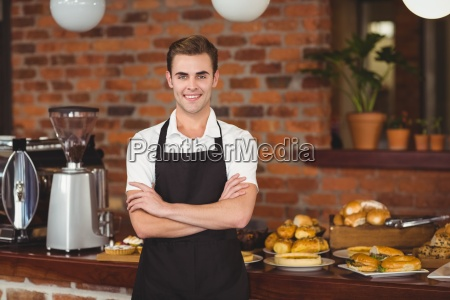 smiling barista in front of counter