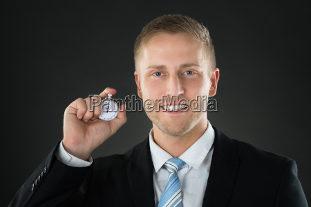 businessman holding stopwatch in his hand