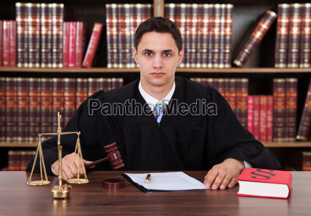 portrait of young judge striking the