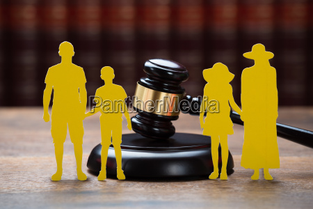 paper family with mallet on table