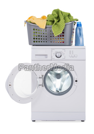 washing machine with basket against white