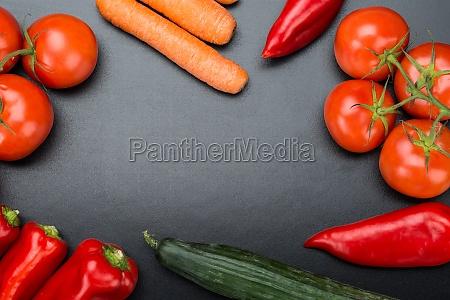 fresh vegetables on blackboard