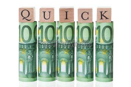 quick blocks arranged on rolled euro