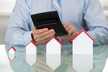 businessman doing calculation on calculator
