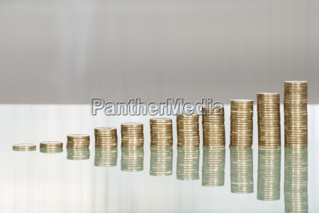 stacked coins on desk