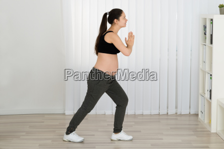 young pregnant woman exercising