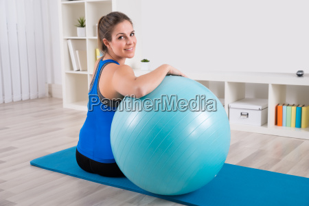 happy woman with fitness ball