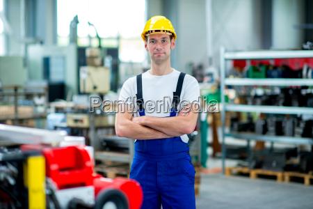 worker with helmet in factory
