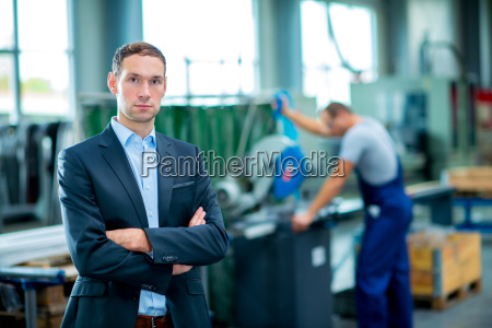 young boss in his factory