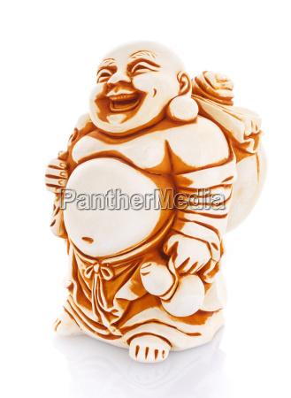 figurine cheerful hotei on a white
