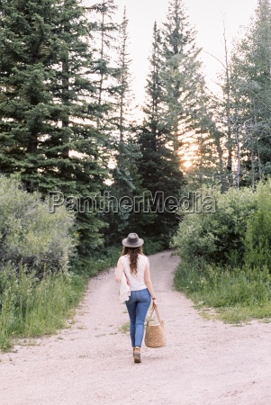 woman walking along a forest path