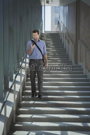 a man with a laptop bag