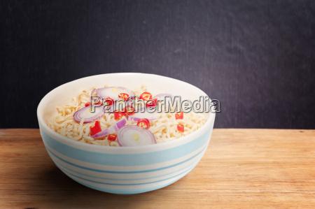 noodle in bowl on dark wooden