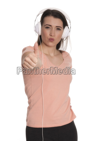 young woman with headphones showing thumbs