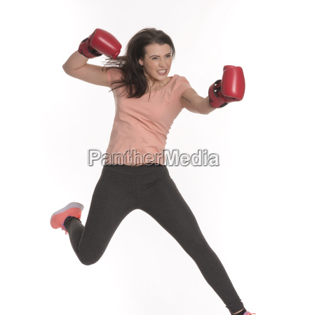 young woman with boxing gloves makes