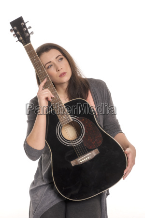 beautiful woman with guitar looking sensual